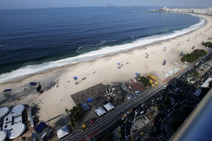 A view of the grandstand in preparation for the visit of Pope Francis on Copacabana beach in Rio de Janeiro on July 17, 2013.Out of respect for Pope Francis, sand artists have covered up the curves of female sculptures on Brazil's world famous