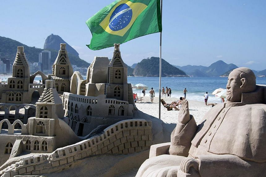 View of a sand statue depicting Pope Francis at Copacabana beach in Rio de Janeiro, Brazil, on July 17, 2013. Pope Francis will be in Brazil from July 22 to 28 on his first foreign trip to be marked by several historic moments, including addressing y