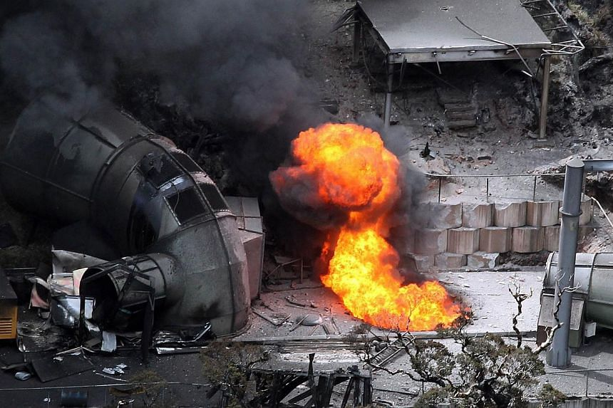 """Flames come out of a ventilation shaft at the Pike River Coal mine near Greymouth on New Zealand's West Coast on Nov 30, 2010. The families of 29 miners killed in a New Zealand pit explosion said on Thursday they were """"gutted"""" by a police decision no"""