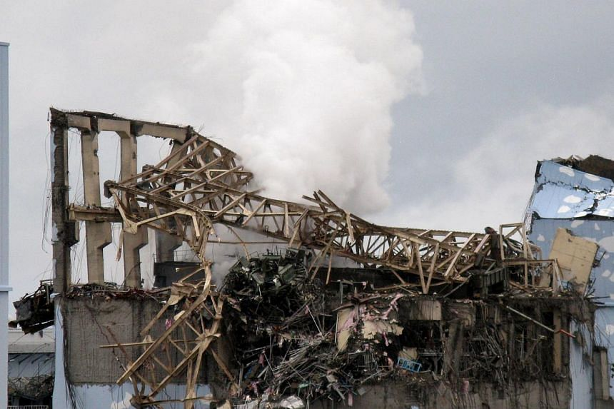 This handout picture taken by Tokyo Electric Power Co (Tepco) on March 15, 2011, shows crippled Fukushima Dai-ichi nuclear plant's unit 3 reactor building at Okuma town in Fukushima prefecture. The Japanese operator said on Thursday that steam has be
