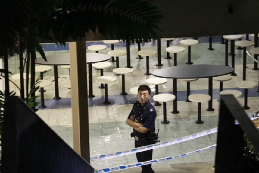 A policeman at the scene of the fire at a food court in Singapore Polytechnic. -- ST PHOTO: KEVIN LIM