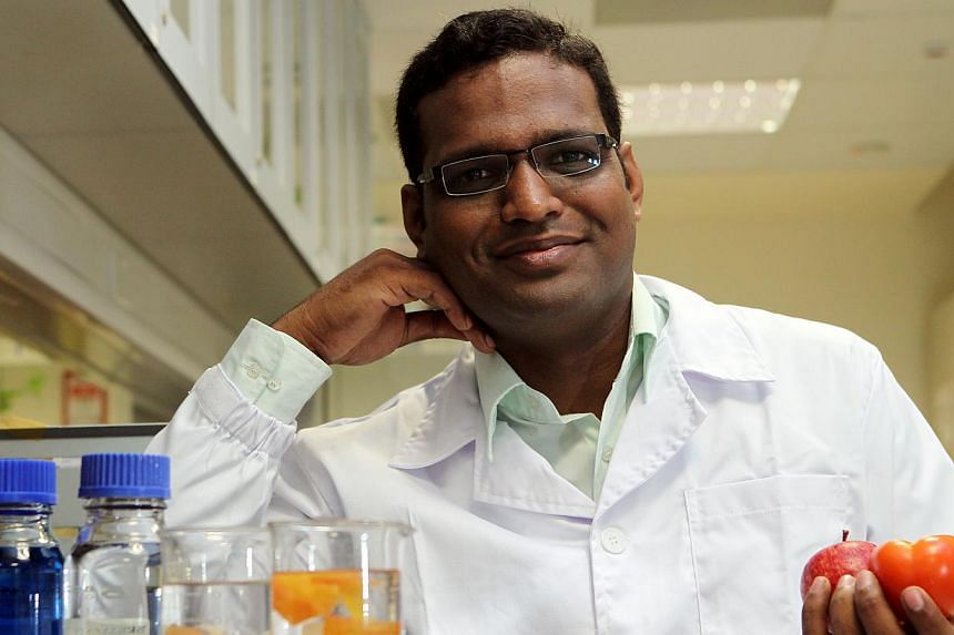 NUS lead researcher Ramakrishna Mallampati (above), has developed low-cost, low-energy and environmental friendly water filtration techniques using fruit and vegetable peels as filters. -- ST PHOTO: SEAH KWANG PENG