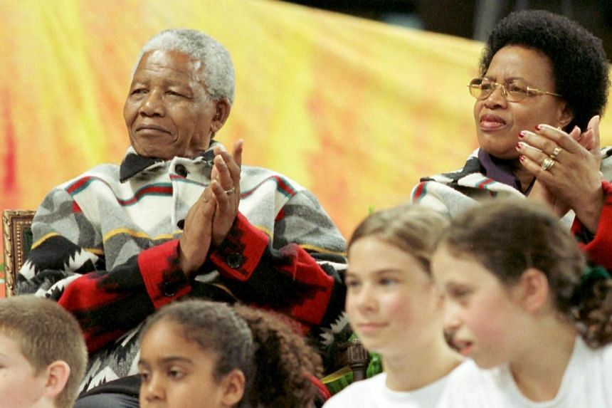 When Mr Nelson Mandela turns 95 on today, he will also mark 15 years of marriage to Ms Graca Machel, who throughout his hospitalisation, has wooed a nation with her dignified poise. -- FILE PHOTO: AFP