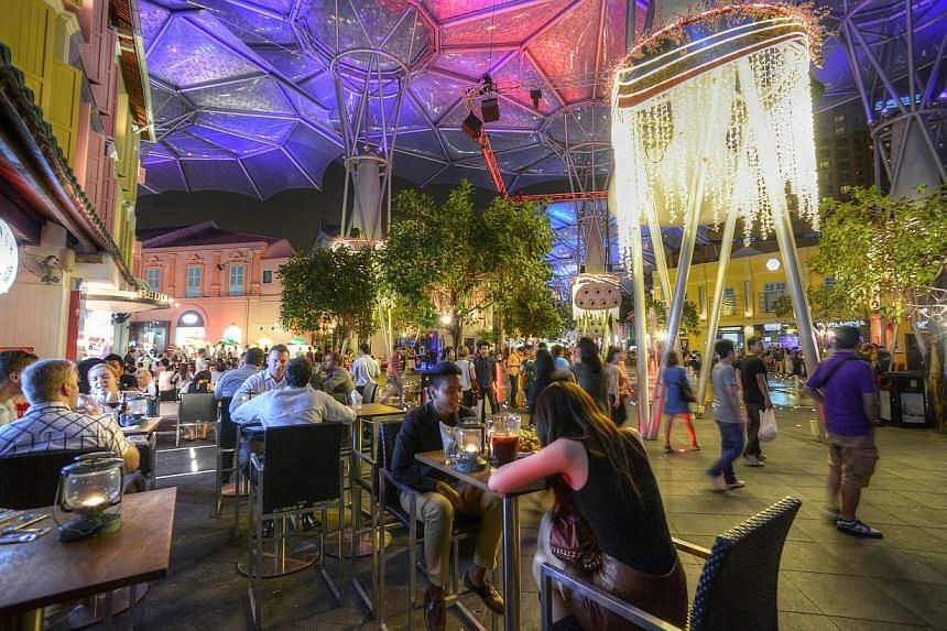 "The new time limits will affect about 20 of the more than 60 tenants in Clarke Quay. A spokesman for Clarke Quay said the area will remain ""a 24-hour entertainment zone"". -- ST FILE PHOTO"