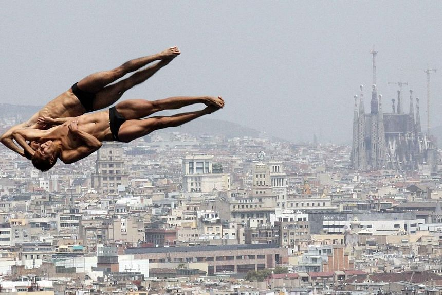 Mexico's Ivan Garcia and German Sanchez perform a dive during a practice for the men's synchronised 10m platform event at the Montjuic municipal pool in Barcelona prior to the World Swimming Championships in Barcelona on Wednesday, July 17, 2013. See