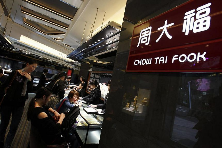 Customers sit inside a Chow Tai Fook jewellery store at Hong Kong's Tsim Sha Tsui shopping district.The world's biggest jewellery retailer by market value is among a number of gold shops being probed for price fixing, the official People's Dail