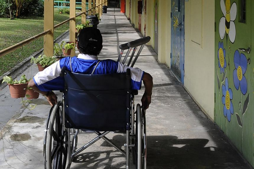 A wheel-chair bound person at the Handicap Welfare Association. Singapore has taken a step closer in guaranteeing equal rights for disabled people here with the ratification of a global agreement on Friday. -- ST FILE PHOTO: ASHLEIGH SIM
