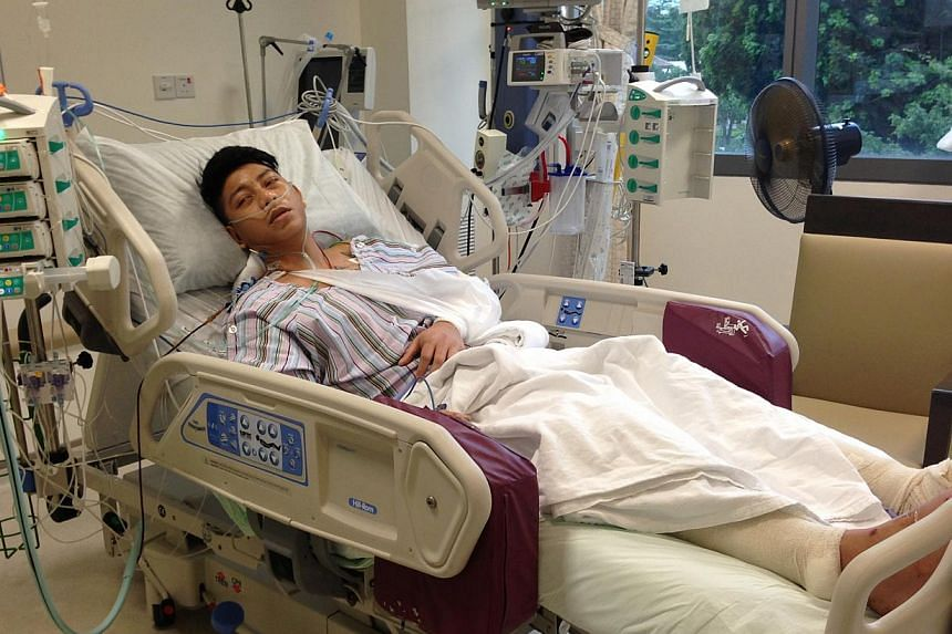 Mr Mohammad Ashiq Sabtu broke his legs and left arm while trying to shield himself from an attack by his cousin and friend. A 26-year-old man was charged on Friday with causing grievous hurt to Mr Sabtu over the weekend.-- ST FILE PHOTO: CAROLINE CHI