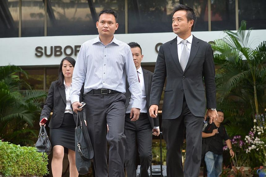 Lim Kwo Yin (left), 36, who was found guilty of causing the death of an inmate by negligence, had failed to adequately supervise his men when they were restraining the deceased, Dinesh Raman Chinnaiah, the court heard. -- ST PHOTO: ALPHONSUS CHERN