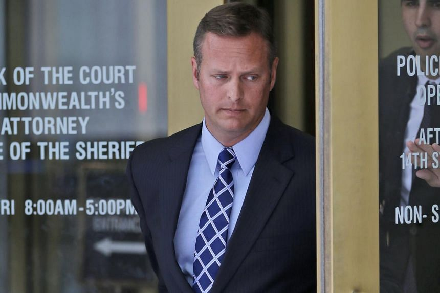 Jeffrey Krusinski, who led the Air Force's Sexual Assault Prevention and Response unit, is seen leaving the Arlington County General District Court, Thursday, July 18, 2013 in Arlington, Virginia. A charge of sexual battery against Krusinski, in a ca