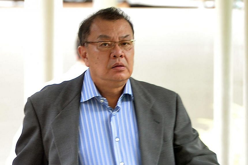 Former prosecutor Spencer Gwee Hak Theng (above) was sentenced by a district court on Friday, July 19, 2013, to four months in jail for having sex with an underage prostitute. -- ST PHOTO: ALPHONSUS CHERN