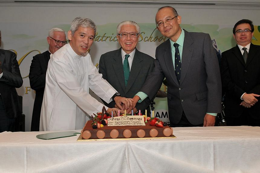 St Patrick's School celebrated its 80th anniversary on Friday evening at the Marina Mandarin Ballroom with guest-of-honour President Tony Tan (centre), a former student of the school. -- PHOTO: ST PATRICK'S SCHOOL
