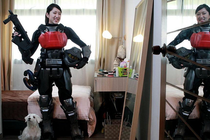 Ms Sueanne Teo, a video editor and gamer girl, dressed as a Halo video game character. -- ST PHOTO: NEO XIAOBIN