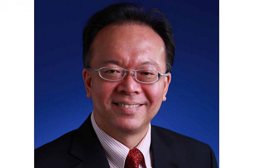 Managing partner of auditing firm KPMG in Singapore, Mr Tham Sai Choy (above), will become its Asia Pacific chairman as of Oct 1, 2013. -- FILE PHOTO: KPMG