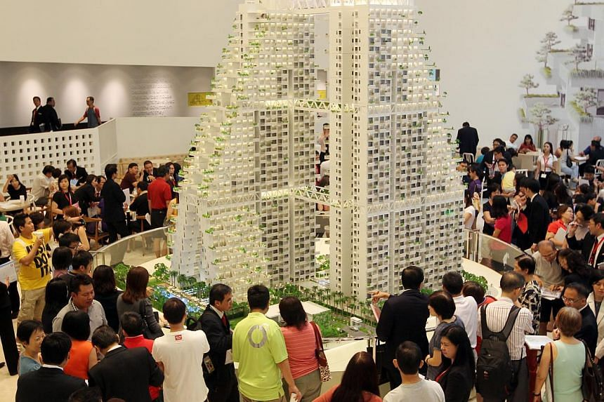 Crowds thronging the showroom on the first weekend of the launch of CapitaLand's Moshe Safdie-designed Sky Habitat condominium in Bishan. Recent property measures have put a squeeze on the number of Housing Board dwellers buying private proper