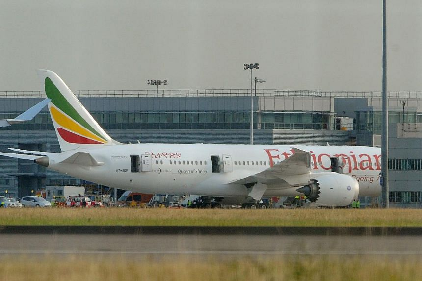 Air Ethiopian Boeing 787 Dreamliner 'Queen of Sheeba' aeroplane, on the runway near Terminal 3, at Heathrow Airport, London, on Friday, July 12, 2013. Officials investigating the fire on an Ethiopian Airlines 787 in London last week are focused on ho