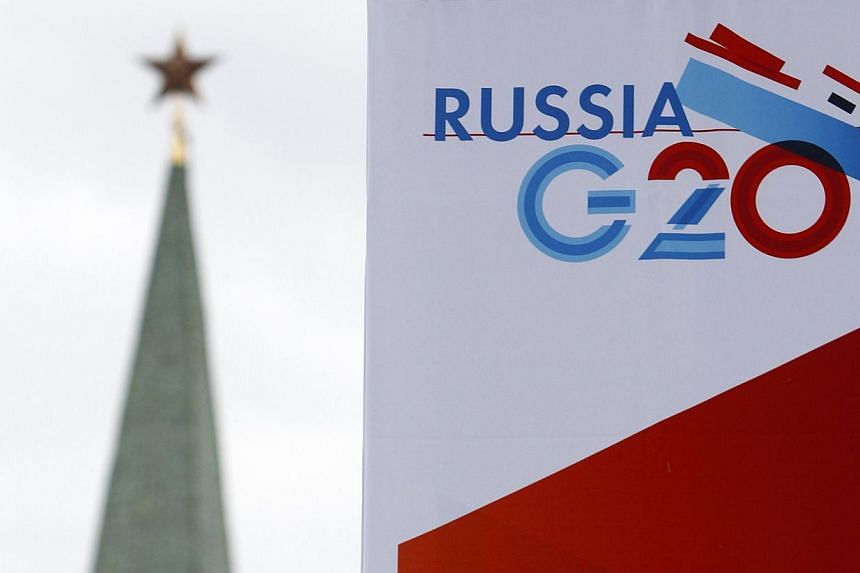 A tower of the Kremlin is seen behind a sign hanging on the Manezh Exhibition Center, venue for this week's meeting of G20 Finance Ministers, in Moscow on July 16, 2013.Two United States (US) senators introduced a resolution on Friday seeking a