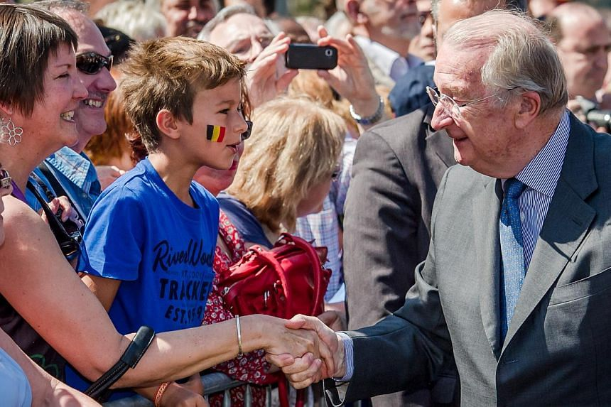Belgium's King Albert II greets the public during the last day of his 3-day farewell tour in Liege, Belgium, on Friday, July 19, 2013. In a fractious nation ever more divided by language, it may be too much to ask for a royal to hold it all together.