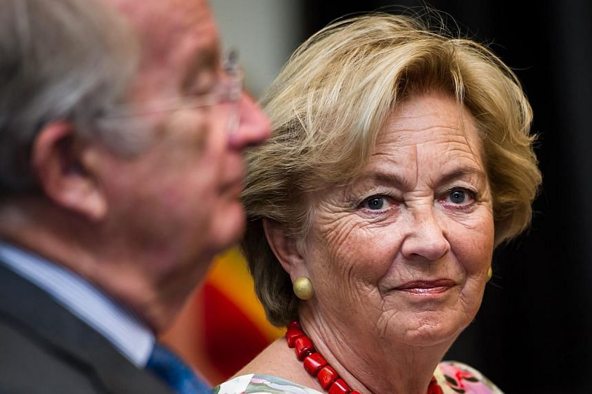 Belgium's King Albert II and Queen Paola arrive in Liege, Belgium, for the last day of their 3-day farewell tour on Friday, July 19, 2013. In a fractious nation ever more divided by language, it may be too much to ask for a royal to hold it all toget