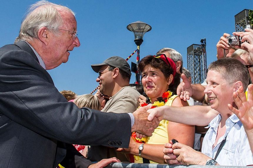 Belgium's King Albert II greets the public during the last day of his 3-day farewell tour in Liege, Belgium, on Friday, July 19, 2013. In a fractious nation where even the monarchy is a fraying symbol of unity, Belgian King Albert on Sunday hands ove