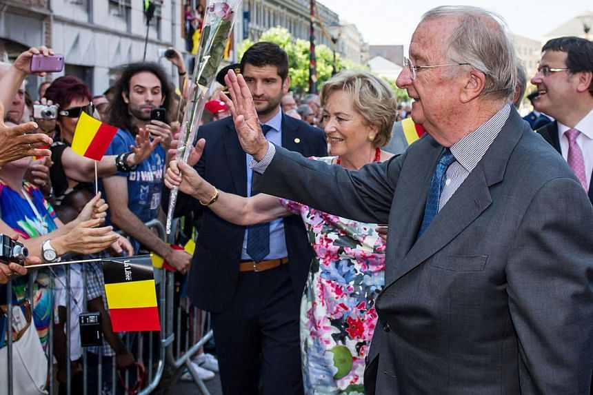 Belgium's King Albert II and Queen Paola greet the public during the last day of their 3-day farewell tour in Liege, Belgium, on Friday, July 19, 2013. In a fractious nation where even the monarchy is a fraying symbol of unity, Belgian King Albert on