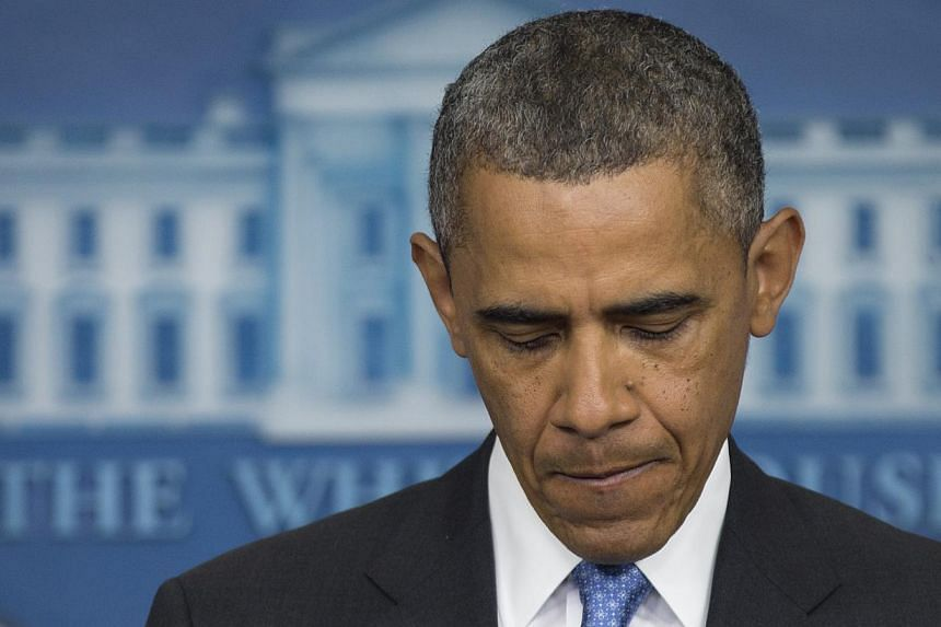 President Barack Obama pauses as he speaks during the daily news briefing at the White House, on Friday, July 19, 2013, in Washington, about the fatal shooting of Trayvon Martin by George Zimmerman. Mr Obama offered a very personal take on the death