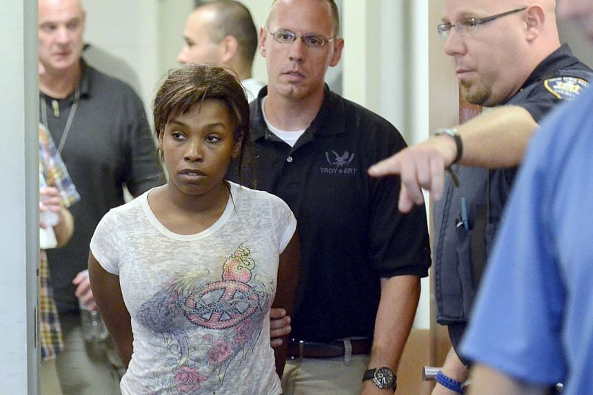 Audrea Gause, 26, is led into court on Friday, July 19, 2013 to be arraigned on a Massachusetts fugitive warrant. Gause was charged on Friday with attempted larceny for collecting a fraudulent US$480,000 (S$608,000) claim from a charity set up to ben