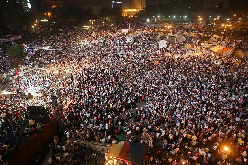 Opponent of ousted President Mohammed Morsi gather during a rally at Tahrir square, in Cairo, Egypt, late Friday, July 19, 2013. Three women died in clashes between loyalists and opponents of Egypt's ousted Islamist president Mohamed Mursi, medics sa