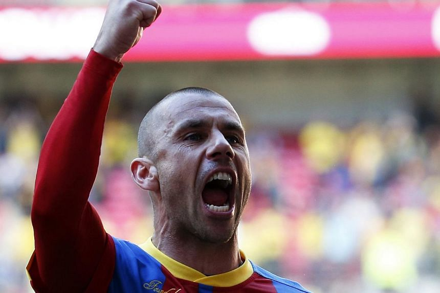 Crystal Palace's Kevin Phillips celebrates after winning their Championship play-off final football match against Watford at Wembley Stadium in London on Monday, May 27, 2013. Phillips has been rewarded with a new contract after the veteran's play-of