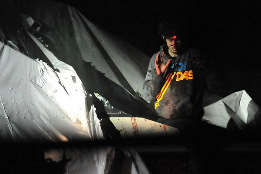 Sergeant Sean Murphy, who said Rolling Stone's portrait of Dzhokhar Tsarnaev glamorised 'the face of terror', released his own images showing him bloody and dishevelled (above), with a sniper's rifle laser sight trained on him. -- PHOTOS: REUTERS, SE