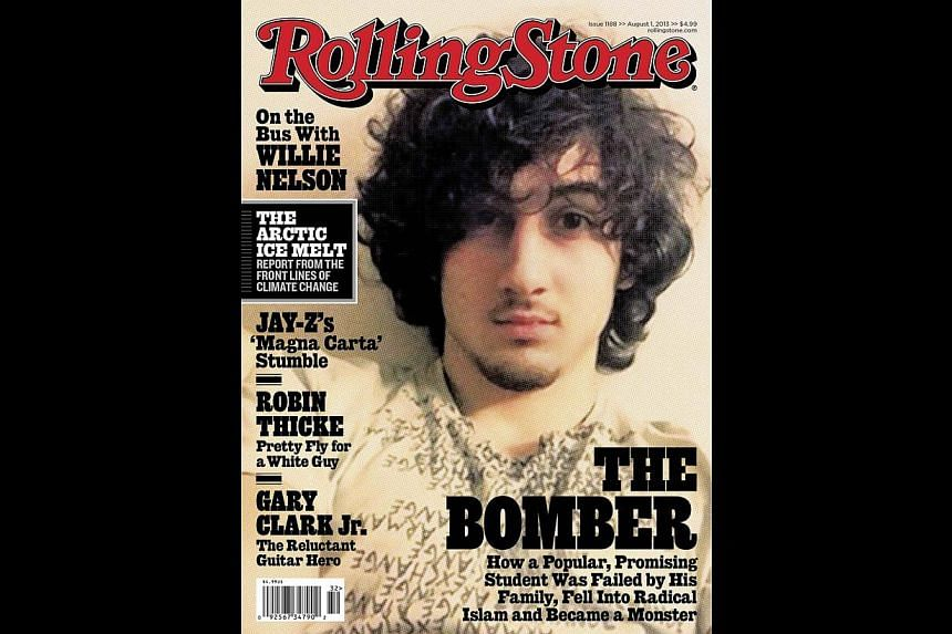 Sergeant Sean Murphy, who said Rolling Stone's portrait of Dzhokhar Tsarnaev (above) glamorised 'the face of terror', released his own images showing him bloody and dishevelled, with a sniper's rifle laser sight trained on him. -- PHOTOS: REUTERS, SE