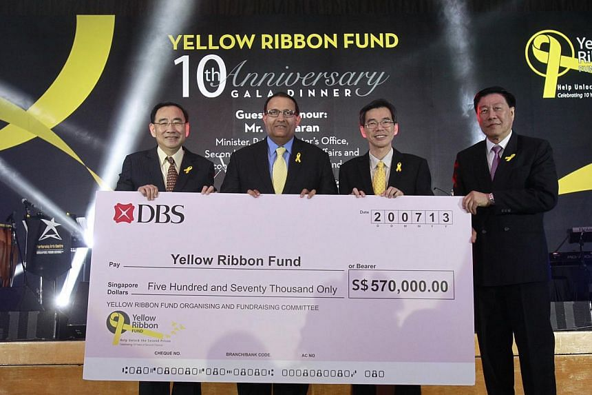 (From left) Mr Phillip Tan, chairman of The Yellow Ribbon Fund, Guest-of-honour and Minister Prime Minister's Office, Second Minister for Home Affairs and Second Minister for Trade and Industry Mr S Iswaran, Mr Soh Wai Wah, Director of Prisons, and M