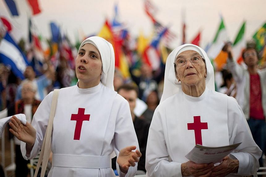 Nuns attend a Catholic Mass ahead of World Youth Day in Sao Paulo, Brazil, Saturday, July 20, 2013. Pope Francis will travel to Brazil and participate in WYD events from July 22-28. -- PHOTO: AP