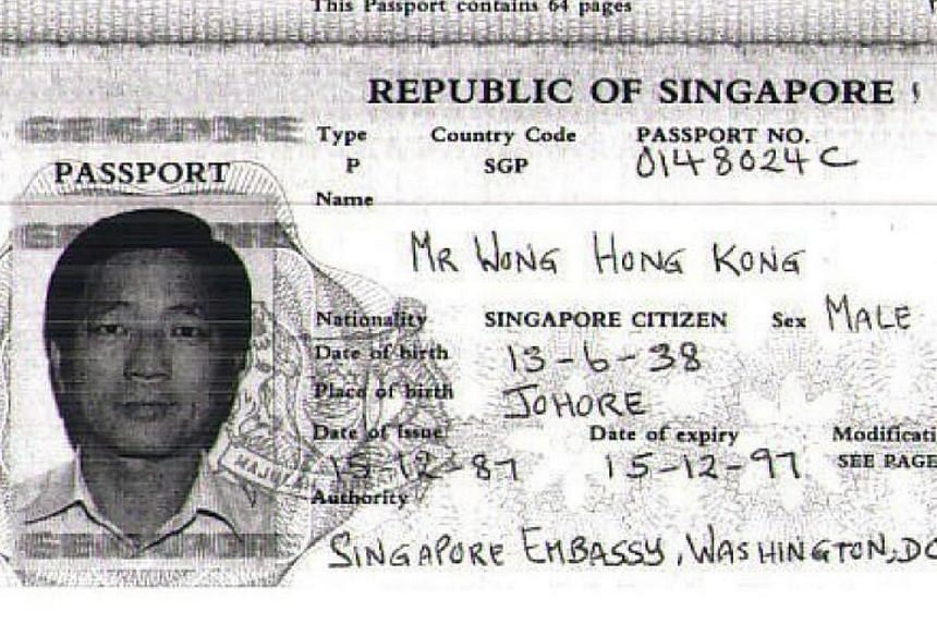 Mr Wong Hong Kong's Singapore passport (above) and photographs which were found among his possessions. It is believed that Mr Wong's son is one of the three men in the photo. Mr Wong died of liver cancer in Puerto Rico in April, and was said to have
