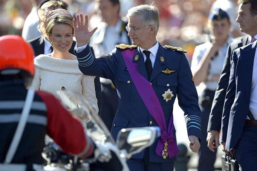 Belgium's Prince Philippe (centre) and his wife Princess Mathilde (second from right), wave to the crowd as they leave a church service at the St Gudule cathedral in Brussels on Sunday, July 21, 2013. Albert II abdicated on Sunday after 20 years as '