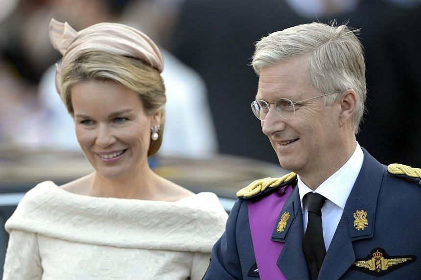 Belgium's Prince Philippe (right) and his wife Princess Mathilde smile as they leave a church service at the St Gudule cathedral in Brussels on Sunday, July 21, 2013. Albert II abdicated on Sunday after 20 years as 'King of the Belgians'in favo