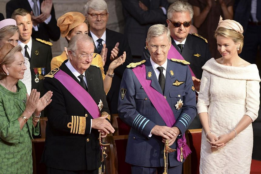 Royal family members (front from left) Queen Fabiola, Queen Paola, King Albert II, Prince Philippe and his wife Princess Mathilde attend a church service at the St Gudule cathedral in Brussels on Sunday, July 21, 2013. Albert II abdicated on Sunday a