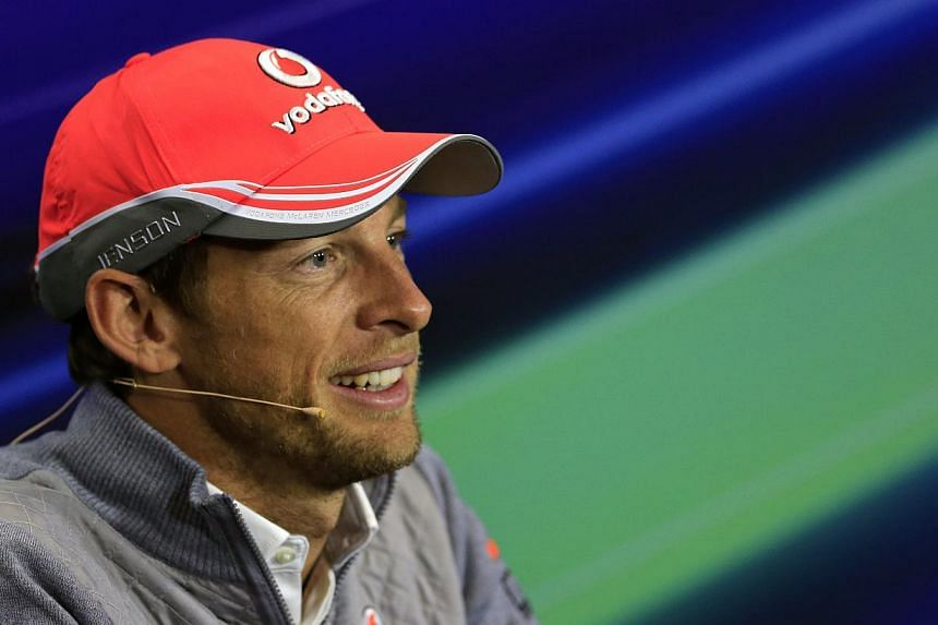 Former world champion Jenson Button (above) has given his backing to next year's Sochi Formula One Grand Prix. -- FILE PHOTO: AFP