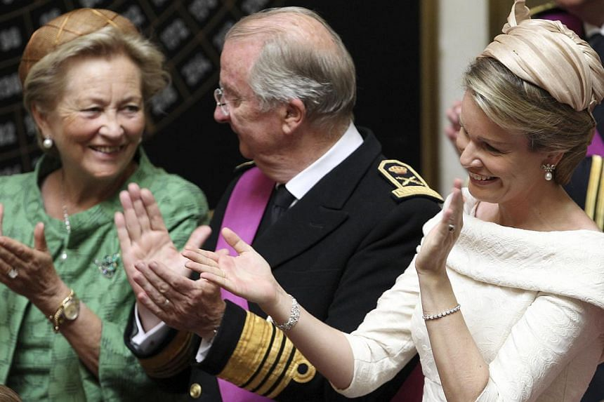 (From left) Belgium's Queen Paola, King Albert II and Princess Mathilde applaud after the speech of Belgium's Prince Philippe at the Palace of the Nation in Brussels on Sunday, July 21, 2013. Philippe ascended to the throne of Belgium as its seventh