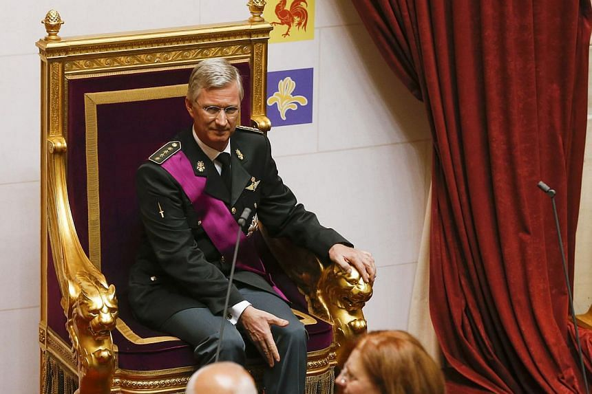King Philippe of Belgium sits on the throne after taking the oath during a ceremony at the Belgian Parliament in Brussels on Sunday, July 21, 2013. Philippe ascended to the throne of Belgium as its seventh king on Sunday amid National Day celebration