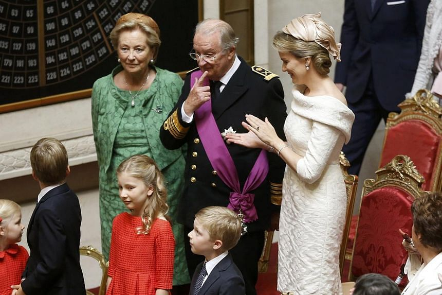 King Albert II of Belgium stands among Queen Paola and Queen Mathilde (right)standduring the coronation ceremony of King Philippe of Belgium at the Belgian Parliament in Brussels on Sunday, July 21, 2013. Philippe ascended to the throne o