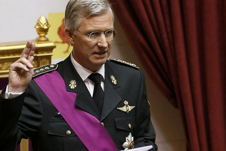 King Philippe of Belgium takes the oath during a ceremony at the Belgian Parliament in Brussels on Sunday, July 21, 2013. Philippe ascended to the throne of Belgium as its seventh king on Sunday amid National Day celebrations marked by hopes the frag
