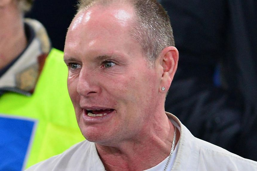Troubled former England football star Paul Gascoigne (above) has been charged with two counts of common assault following an incident at a railway station. -- FILE PHOTO: AFP