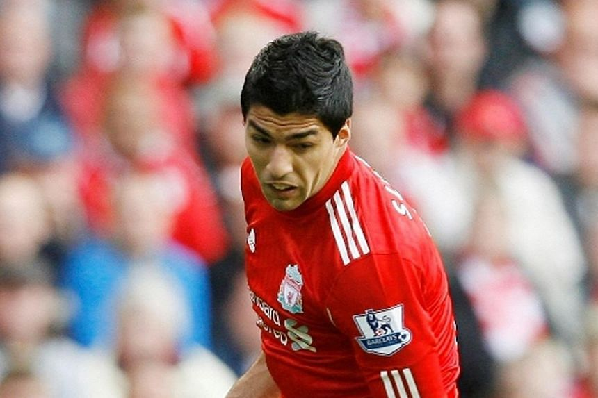 Liverpool manager Brendan Rodgers is set for showdown talks with unsettled star Luis Suarez (above) in Australia as the Uruguay striker continues to seek a move away from Anfield. -- FILE PHOTO: SINGTEL