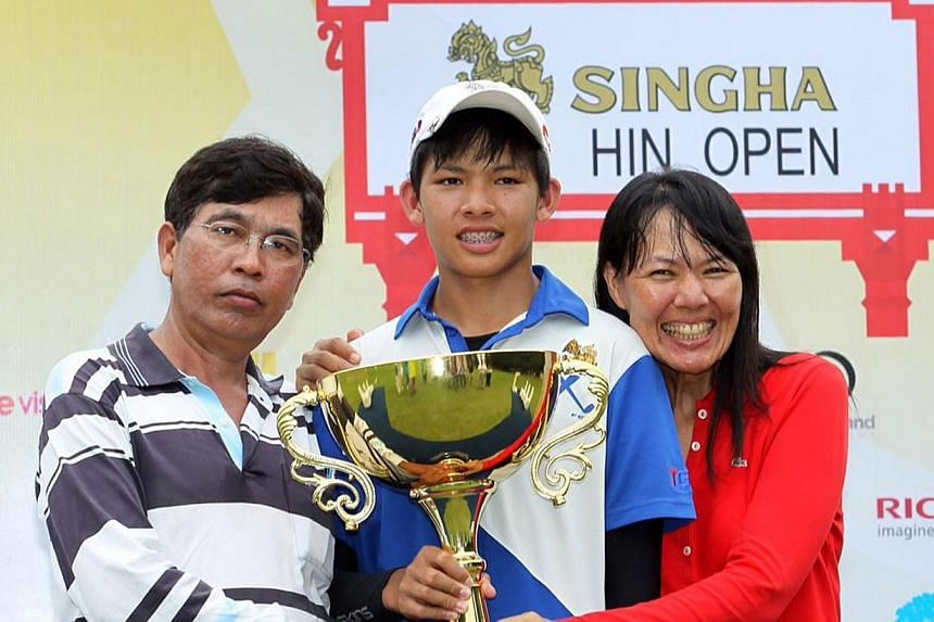 Thailand's Phachara Khongwatmai became the youngest winner of a professional golf tournament when he triumphed at the US$65,000 (S$82,000) Singha Hua Hin Open on Sunday.-- PHOTO:WORLD SPORT GROUP PTE LTD