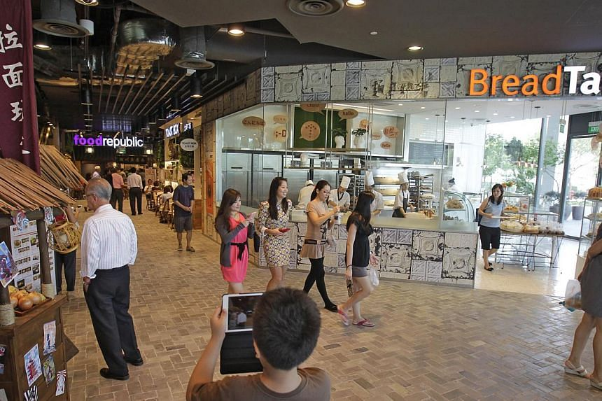 (From left) Ramen Play, Food Republic, Toast Box and BreadTalk on level one of BreadTalk's international headquarters building in Tai Seng. Over 100 companies, which have tapped on a Government fund to improve service standards, said they have seen t