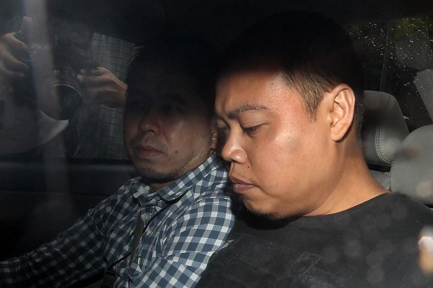 Iskandar Rahmat, the police officer charged with the double murder at Kovan, was remanded for another week for investigations. -- ST FILE PHOTO: LAU FOOK KONG
