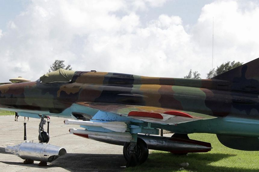 A taxi drives beside a MiG-21 fighter plane at a site displaying other Soviet-made Cold War relics at La Cabana fortress in Havana in this Oct 13, 2012 file photo. Panama said on July 17, 2013 it had called in the United Nations Security Council to i