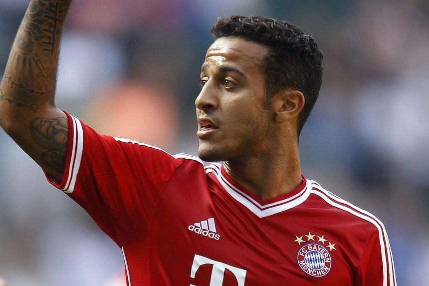 Bayern Munich's Thiago Alcantara gestures during the Telekom Cup soccer match against Hamburg SV in Moenchengladbach on July 20, 2013. Bayern Munich claimed another title with a 5-1 win over hosts Borussia Moenchengladbach in Sunday's final of t