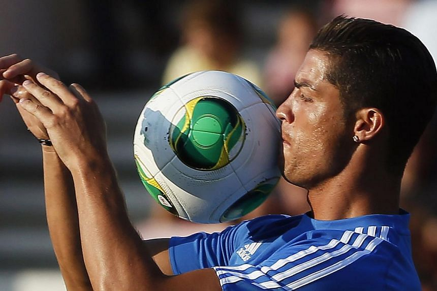 Real Madrid's Cristiano Ronaldo celebrates after scoring against Bournemouth during their friendly soccer match at Dean Court in Bournemouth, on July 21, 2013.Ronaldo and his Real Madrid team-mates enjoyed their trip to the seaside on Sunday as